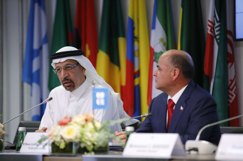 Khalid Al-Falih, Saudi Arabia's energy and industry minister, left, speaks while Manuel Quevedo, Venezuela's petroleum minister and president of the Organization of Petroleum Exporting Countries (OPEC), listens at a news conference following the 176th OPEC meeting in Vienna on July 1, 2019.  NEXT: See the member nations of OPEC.  Photo: Bloomberg Photo By Stefan Wermuth / Bloomberg