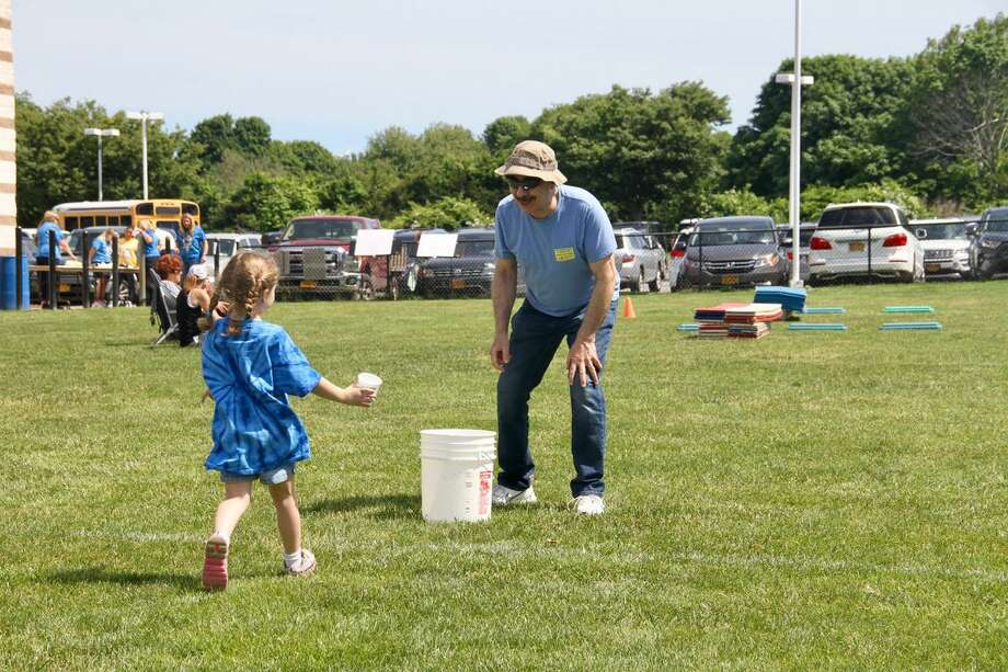 Jerry Zezima has a field day with his 6-year-old granddaughter, Chloe. Photo: Lauren Robert-Demolaize / Contributed Photo