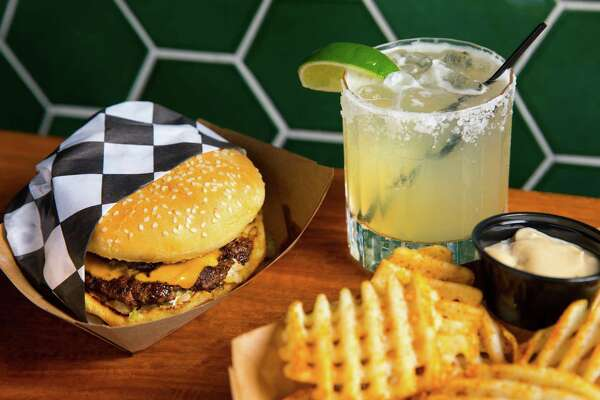 Burger, fries and house margarita at Monkey's Tail, a new Mexican-American bar at 5802 Fulton.