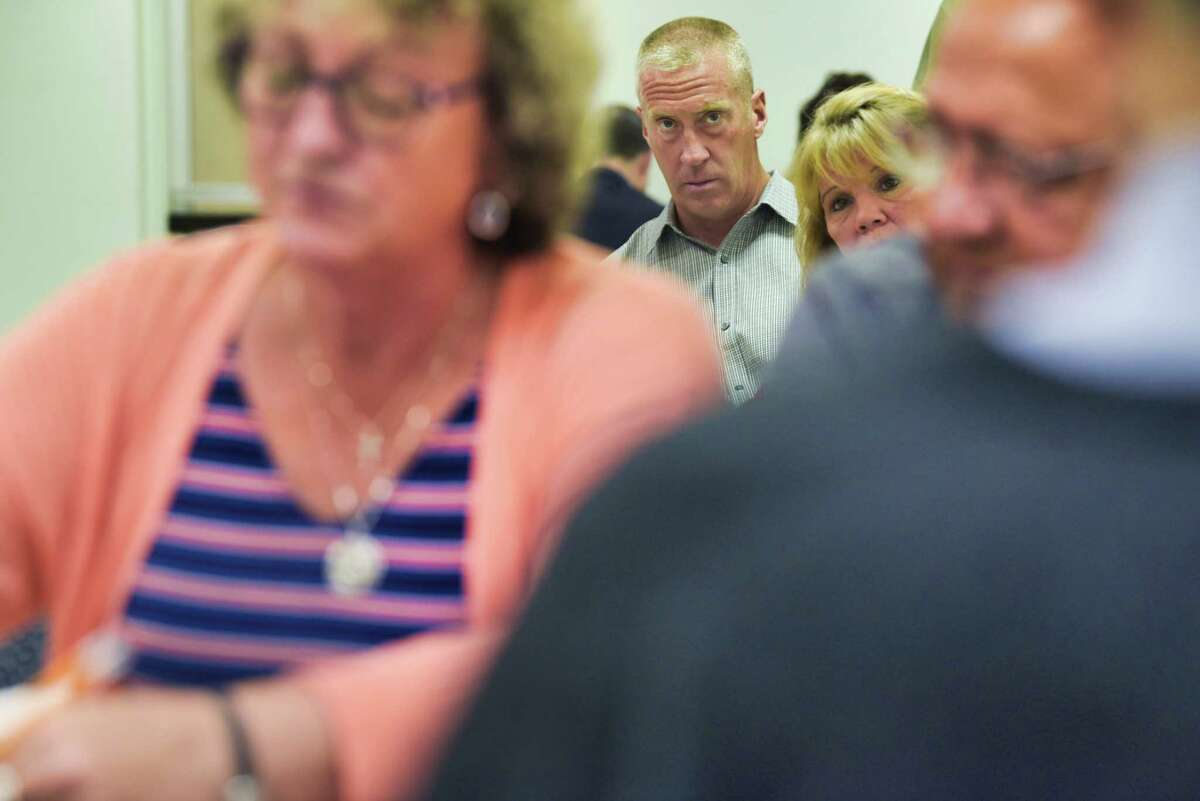 Candidate for Cohoes Mayor, Bill Keeler, background, watches the counting of Cohoes absentee ballots at the Albany County Board of Elections on Tuesday, July 2, 2019, in Albany, N.Y. (Paul Buckowski/Times Union)