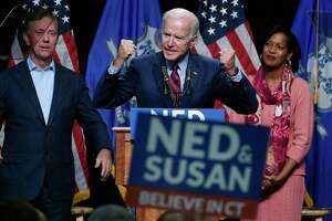 Former Vice President Joe Biden speaks at a rally supporting Democrats as Ned Lamont for candidate for Governor, left, and Jahana Hayes, candidate for Congress, right, look on in Hartford, Conn., Friday, Oct. 26, 2018. (AP Photo/Jessica Hill)