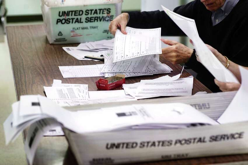 Absentee ballots from Cohoes are counted at the Albany County Board of Elections on Tuesday, July 2, 2019, in Albany, N.Y. (Paul Buckowski/Times Union)