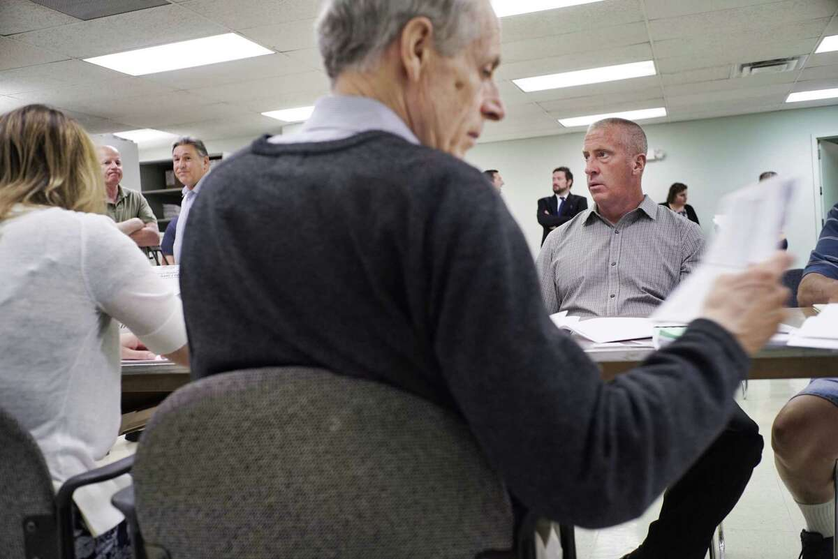Candidate for Cohoes Mayor, Bill Keeler, background right, watches as Rachel Bledi, left, Republican Commissioner, and Matthew Clyne, right, Democratic Commissioner, count the Cohoes absentee ballots at the Albany County Board of Elections on Tuesday, July 2, 2019, in Albany, N.Y. (Paul Buckowski/Times Union)