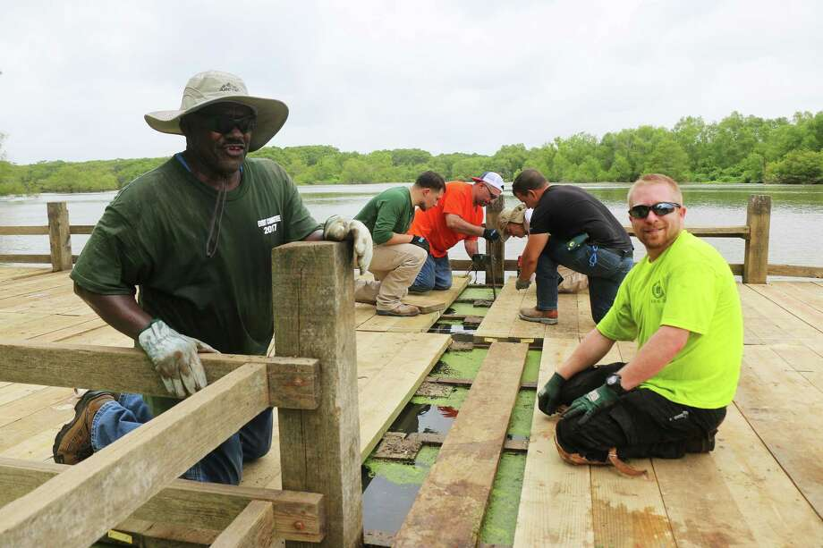 Men and women from several AFL-CIO union locals were on hand last Saturday to help rebuild the pier on Champion Lake. They not only did the hard labor but also paid for the project. Photo: David Taylor / Staff Photo