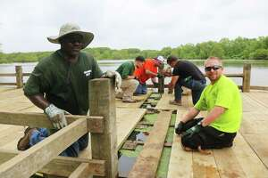 Men and women from several AFL-CIO union locals were on hand last Saturday to help rebuild the pier on Champion Lake. They not only did the hard labor but also paid for the project.