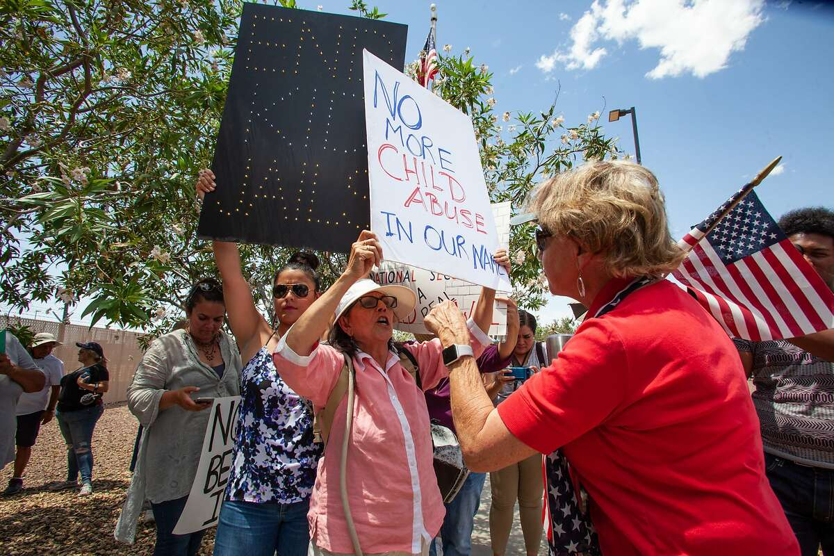 CLINT, TX - JULY 01: Protester retired school teacher Carmen Rubio from El Paso (Center) argues with a counter protesters outside of the Clint Border Patrol station on July 1, 2019 in Clint, Texas. Reports of inhumane conditions have plagued the facility where migrant children are being held. (Photo by Christ Chavez/Getty Images)