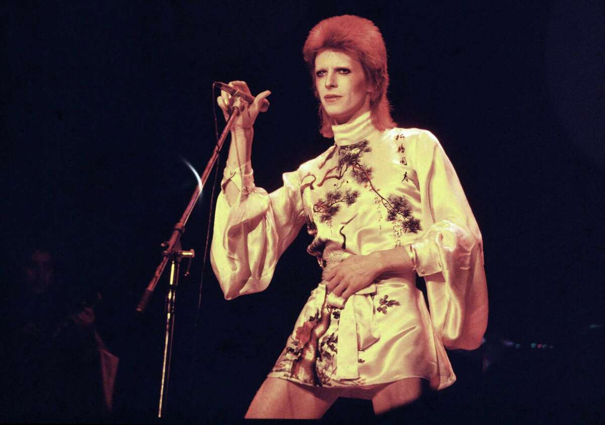 """David Bowie performs on stage on his Ziggy Stardust/Aladdin Sane tour in London, 1973. Bowie introduced Major Tom, his fictitious astronaut, on 1969's """"Space Oddity."""""""