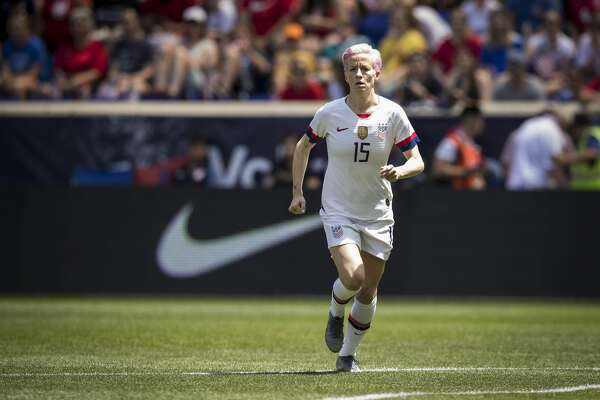 HARRISON, NJ - MAY 26: Megan Rapinoe #15 of United States runs during warm ups with the Nike logo behind her during the International Friendly match the U.S. Women's National Team and Mexico as part of the Send Off Series prior to the FIFA Women's World Cup at Red Bull Arena on May 26 2019 in Harrison, NJ, The United States won the match with a score of 3 to 0. USA. (Photo by Ira L. Black/Corbis via Getty Images)