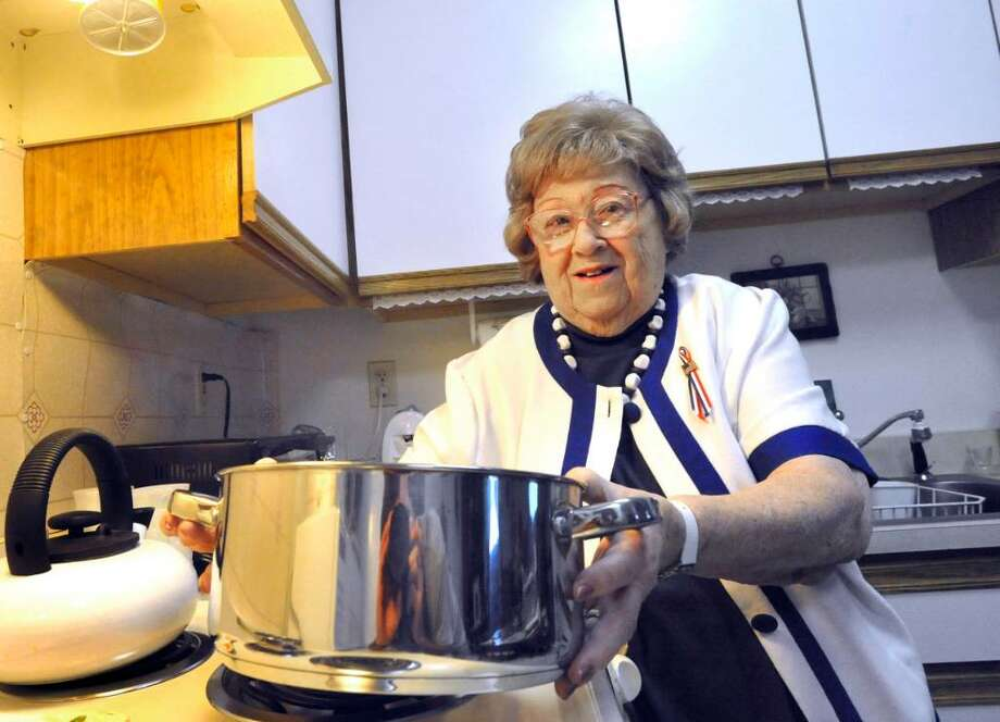 Mary Rickert, 89, puts a pot of pasta on the stove in the kitchen of her Danbury apartment, Friday, July 30, 2010. She was a WAVE in WWII. Photo: Michael Duffy / The News-Times