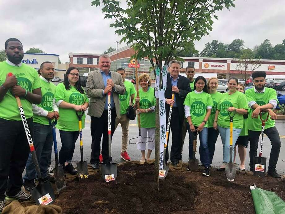 ShopRite of Cromwell, Kimberly-Clark and One Tree Planted representatives stand, shovels in hand, near newly planted tree outside the ShopRite of Cromwell at 45 Shunpike Road June 25. The company's goal is to plant up to 25,000 trees in ShopRite communities. Photo: Contributed Photo