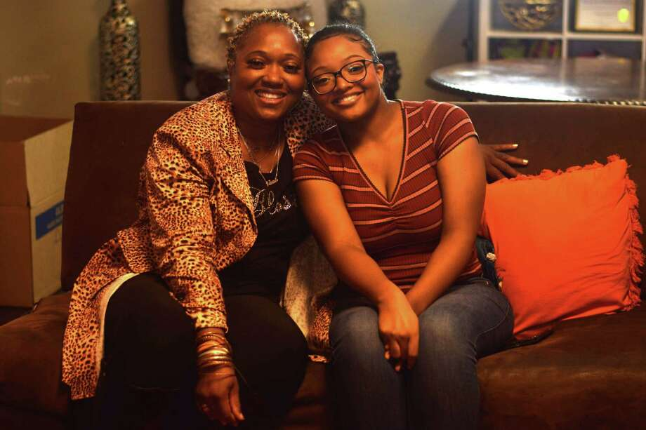 Dyanna Tucker (right) had life-changing brain surgery in May, funded by her mother selling apparel and the help of the Houston community. Photo: Chevall Pryce