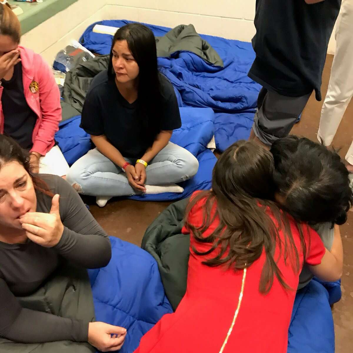 This image, captured by Rep. Joaquin Castro, shows Rep. Alexandria Ocasio-Cortez hugging a migrant she spoke to at a Border Patrol facility on July 1, 2019.