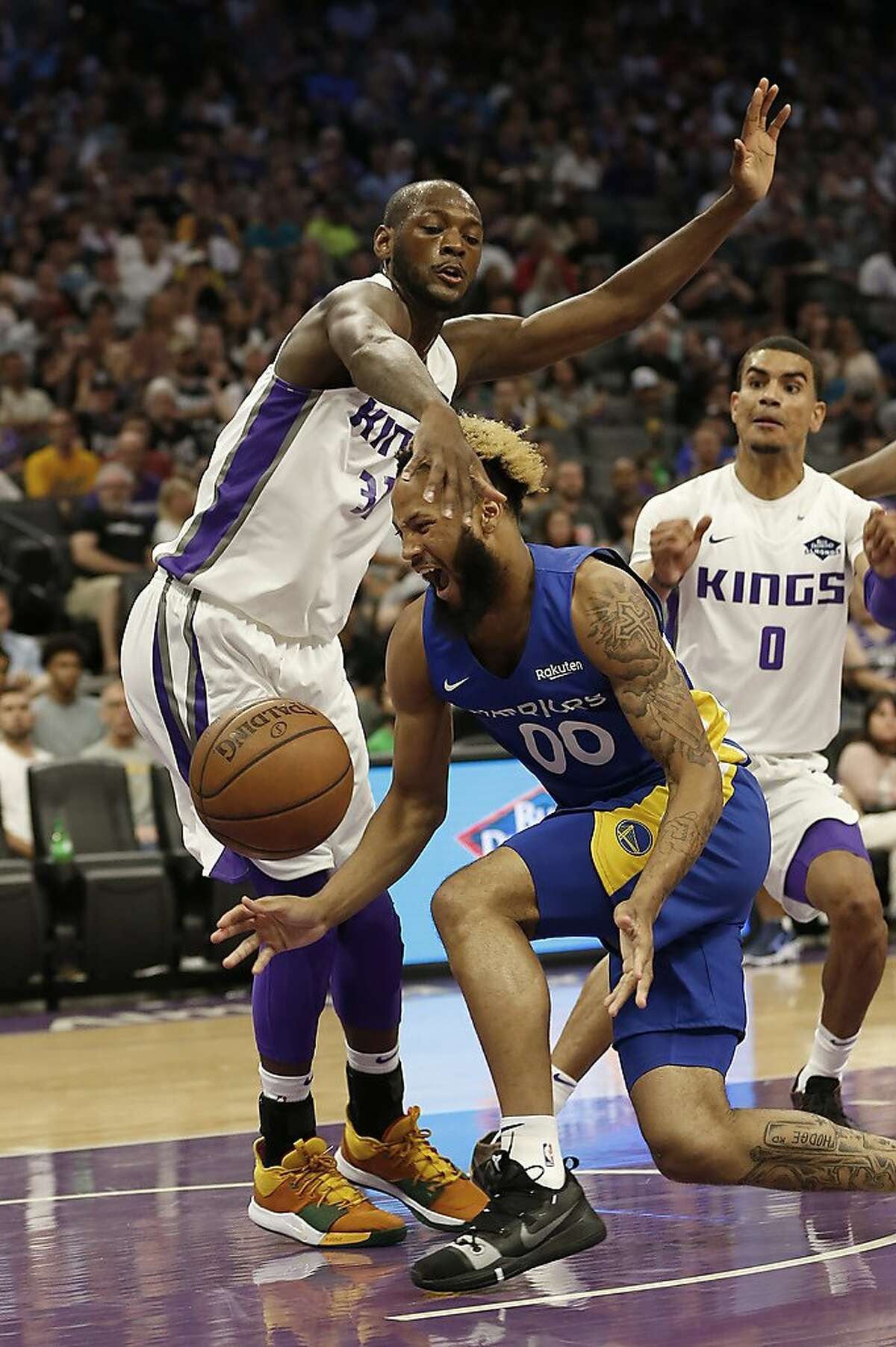 Golden State Warriors guard Ky Bowman, right, loses the ball as he goes to the basket against Sacramento Kings guard Milton Doyle, left, during the first half of a NBA basketball summer league game in Sacramento, Calif., Monday, July 1, 2019. The Kings won 81-77. (AP Photo/Rich Pedroncelli)