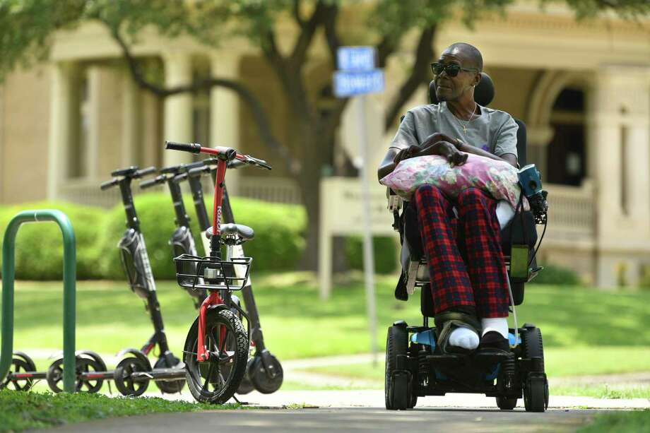 Lorne Self, 57, who broke his lower vertebrae in a car accident, sits at Crockett Park last month. He said scooters discarded on sidewalks often give him trouble as he navigates his way around town. Photo: Billy Calzada /Staff Photographer / San Antonio Express-News