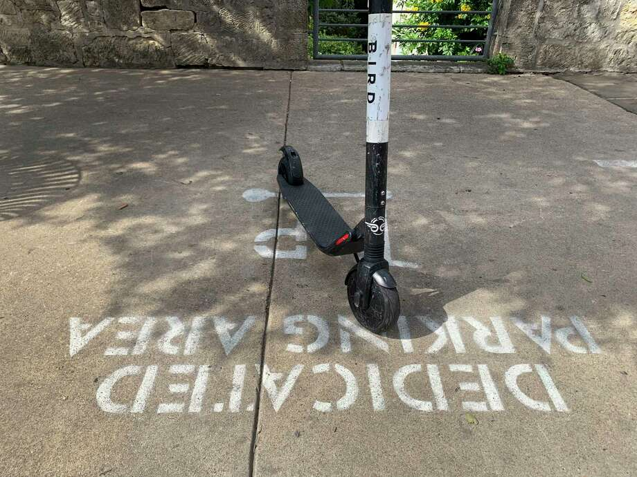 A Bird scooter parked in a designated sidewalk spot. Photo: Billy Calzada /Staff Photographer / San Antonio Express-News