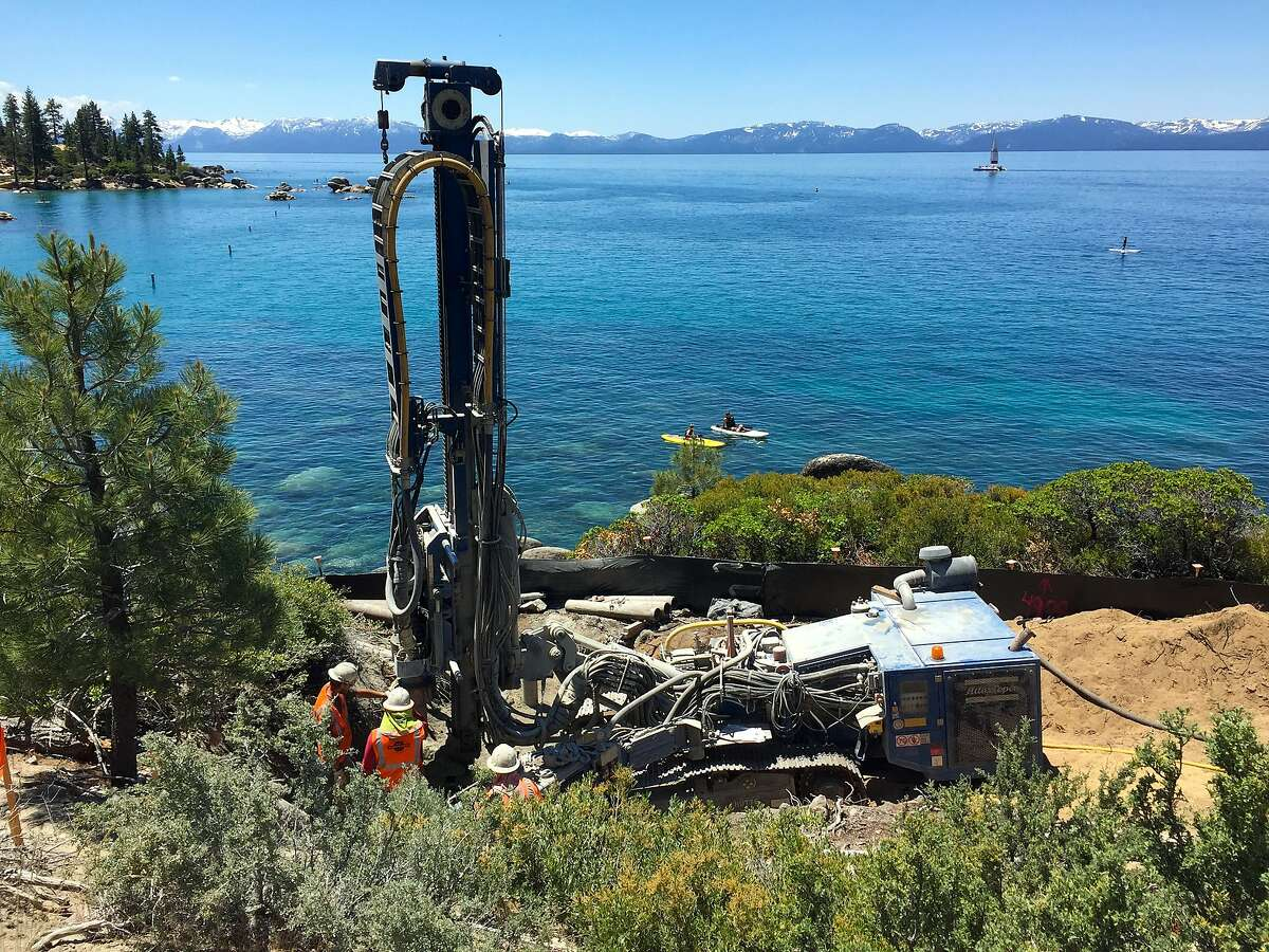 A crew works to install pilings for a bridge for a new section of the Tahoe Bike Trail that connects Incline Village to Sand Harbor State Park