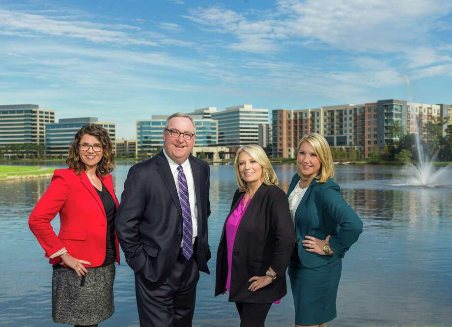 The Woodlands Area Economic Development Partnership has announced its move to Lake Front North, Building 2, in Hughes Landing effective Aug. 1, 2019. Staff members include (from left) Laura Lea Palmer, Vice President of Business Retention and Expansion; Gil Staley, Chief Executive Officer; Holly Gruy, Chief Operating Officer; and Ashley Byers, Manager of Marketing and Outreach. Photo: Courtesy Photo / Hasselblad H5D