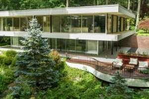 This Mid-century modern home, located at 9 Tallwoods Rd. in Armonk, NY and currently for sale through Houlihan Lawrence, is situated strategically amongst the trees, lending it an inviting 'treehouse' feel.