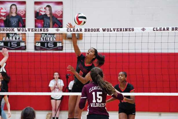 Clear Brook's Kailin Newsome (5), shown in a match earlier this season, hammered 33 kills to power the Lady Wolverines to a five-set win over Clear Springs Tuesday night.