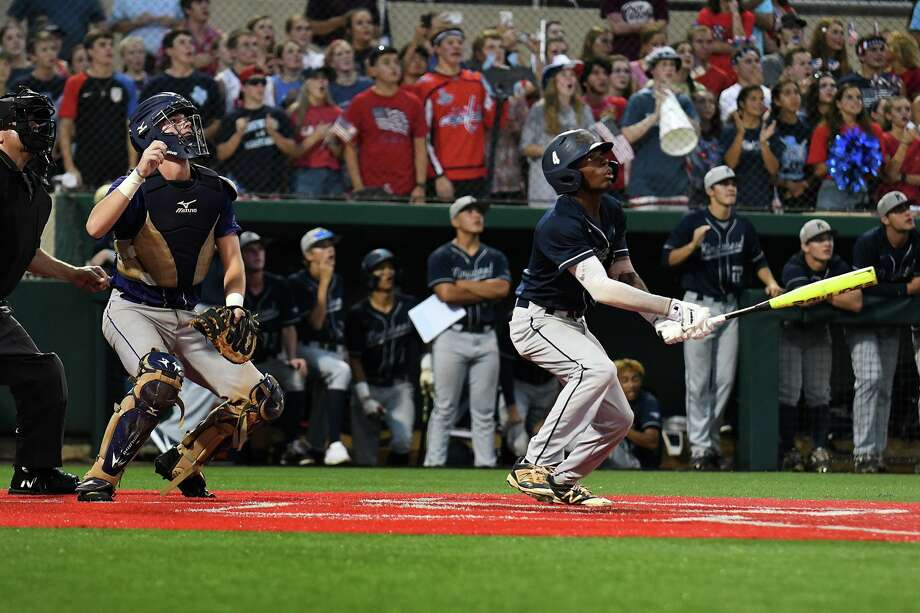 Kingwood senior shortstop Tre Richardson, right, and Ridge Point catcher Will Pendergrass follow Richardson's hit to deep right field in the bottom of the 2nd inning against Ridge Point pitcher Tanner Bond in game one of their Region III-6A final at the University of Houston on Friday, May 30, 2019. Photo: Jerry Baker, Houston Chronicle / Contributor / Houston Chronicle