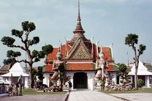 """Temple of Wat Arun, Bangkok, Thailand    Modern-day visitors to the Temple of Wat Arun might  be surprised  at what they find. After undergoing a major renovation that ended in 2017, there was a significant amount of backlash over the result as many claimed the temple had been """"whitewashed."""" The restoration committee stood by their work, saying that they had  simply removed years of moss returning the building to its original glory. Regardless, pictures of the temple today and those from 50 years ago will look  significantly different.    This slideshow was first published on  theStacker.com"""