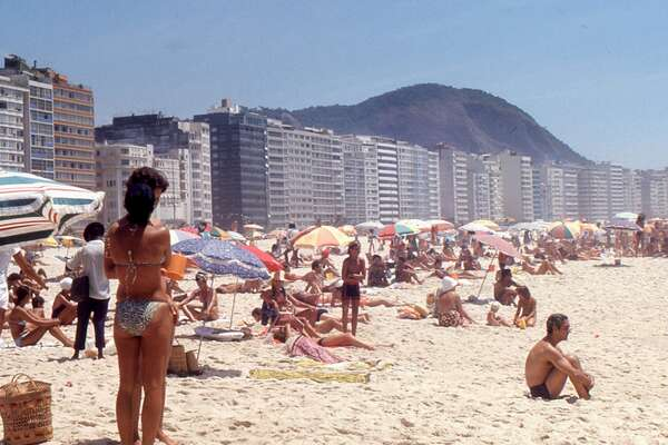 Copacabana Beach, Rio de Janeiro, Brazil Before 1970, Copacabana Beach looked very different than it does today. The road that runs alongside it, Avenida Atlantica, touched the sea in places leaving little or no sandy beach. After a landfill was created that expanded the beach tourism began to spring up in the area. Today restaurants, hotels, and beach kiosks dot the region, including the legendary Belmond Copacabana Palace. This slideshow was first published on theStacker.com
