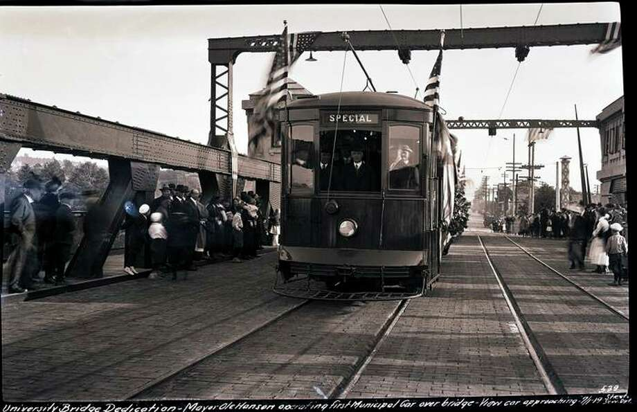 University Bridge dedication, July 1, 1919. Mayor of Seattle Ole Hanson operating first Municipal car over University Bridge. Photo: Courtesy Seattle Municipal Archives