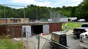 Repair work continues at the South Troy pool on Tuesday, July 2, 2019, on Fourth Street in Troy, N.Y. Reopening of the long-closed pool is delayed. (Will Waldron/Times Union)