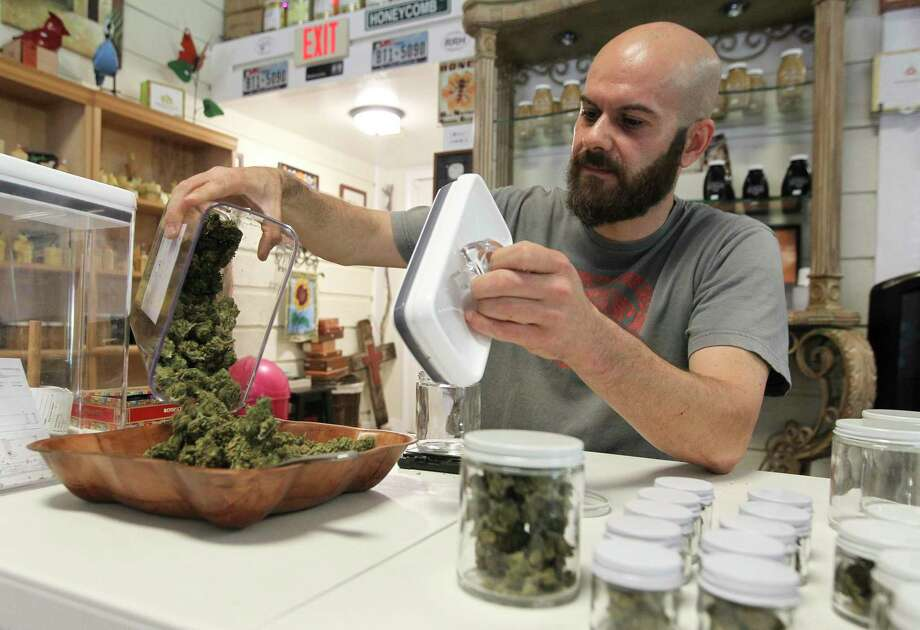 Samuel Luques-Martin, owner of Happy Hippy Haus, pours hemp flowers into a container to sort at his business on Texas-105, Tuesday, July 2, 2019, in Cleveland. Photo: Jason Fochtman, Houston Chronicle / Staff Photographer / Houston Chronicle