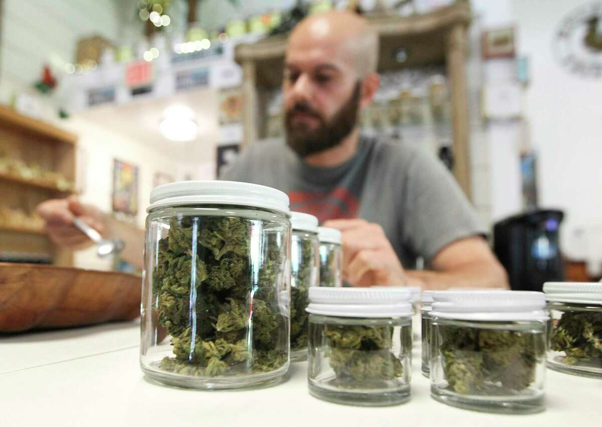 Hemp flowers are seen in containers at Happy Hippy Haus on Texas-105, Tuesday, July 2, 2019, in Cleveland.