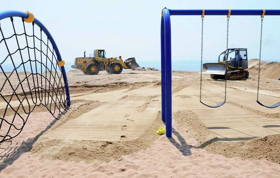 New sand is graded at East Haven Town Beach. Photo: Hearst Connecticut Media File