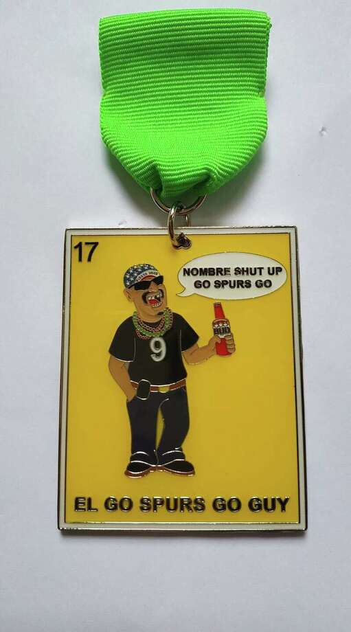 "A front runner in the 2020 collectibles is the resurgence of the 2017 Market Square star, Felipe Aldape, better known as the ""Nombre Shut Up, Go Spurs Go"" guy. His caricature is on a lotería-style medal called ""El Go Spurs Go Guy"" designed by Diana Gonzalez, owner of Diana's Medals. Photo: Courtesy, Diana Gonzalez"