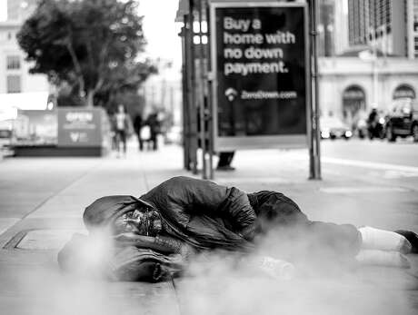 6:38 PM: Ronnie Dixson, who said he's been homeless for 30 years, sleeps by a steam vent in front of the Asian Art Museum (Larkin St. at McAllister St.) on Tuesday, June 18, 2019, in San Francisco.