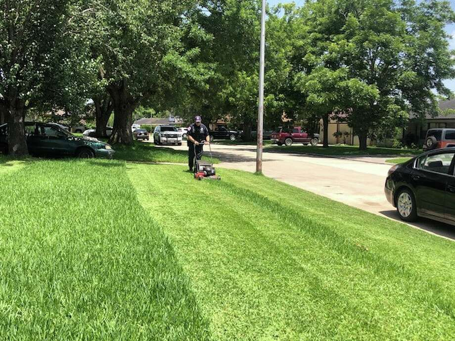 An elderly female in Baytown was reportedly overheated from trying to mow her yard and the neighbors yard on each side of her. Officers took turns mowing for her. She was very thankful and so were the neighbors! Photo: Baytown Police Department