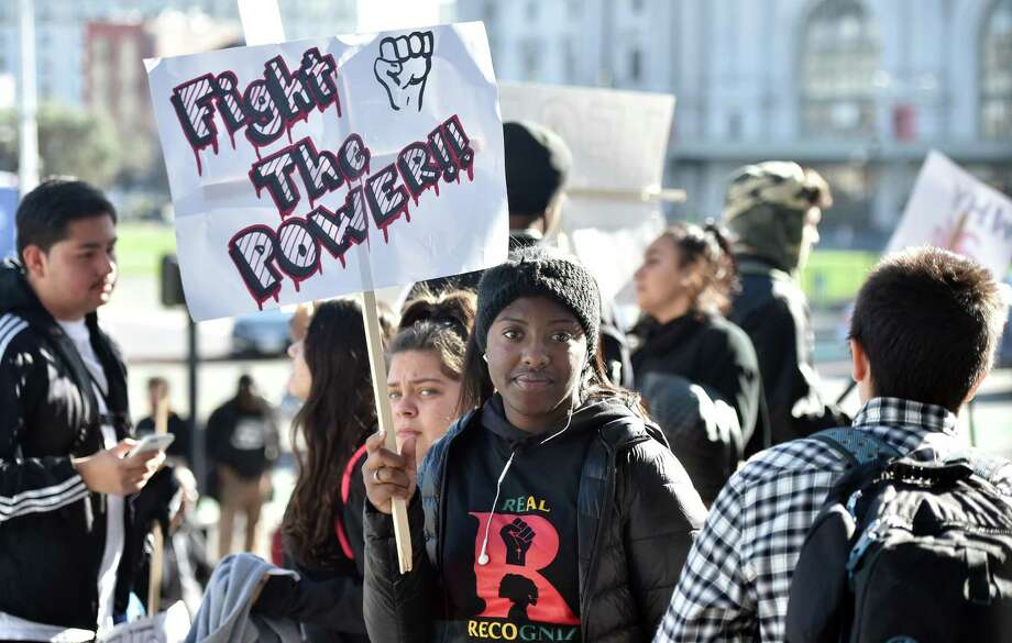 Several high schoolers protesting against police brutality in San Francisco. Dec. 11, 2015. A reader questions what caused police to shoot a suicidal man on I-37, June 25. Photo: /JOSH EDELSON / SAN FRANCISCO CHR / ONLINE_YES