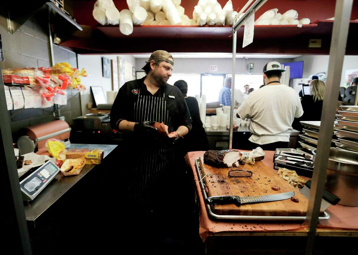 Brett's BBQ Shop pitmaster Brett Jackson prepares an order at his craft barbecue joint in Katy.