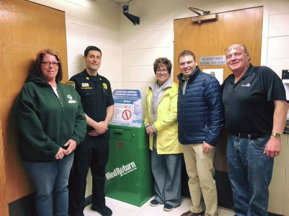 The Woodbridge Police Department and the Woodbridge Rotary Club teamed up in April to promote National Drug Take-Back Day. The Woodbridge Police Department collected 30.3 pounds of unused prescription drugs during the Take-Back Day. A drug take-back box is located at Woodbridge Police Department throughout the year. Pictured are Rotary President-Elect Diane Millan, Sgt A.J. Cappiello, Paula Cofrancesco, Rotary President Spencer Rubin, and Tony Anastasio. Photo: Contributed Photo