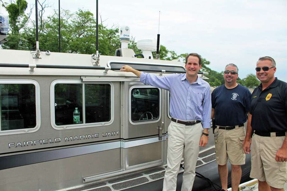 Congressman Himes joined Officers Wiltsie and Perham on a ride along to learn about the Fairfield Police Marine Unit. Photo: Rachel Scharf / Hearst Media Connecticut