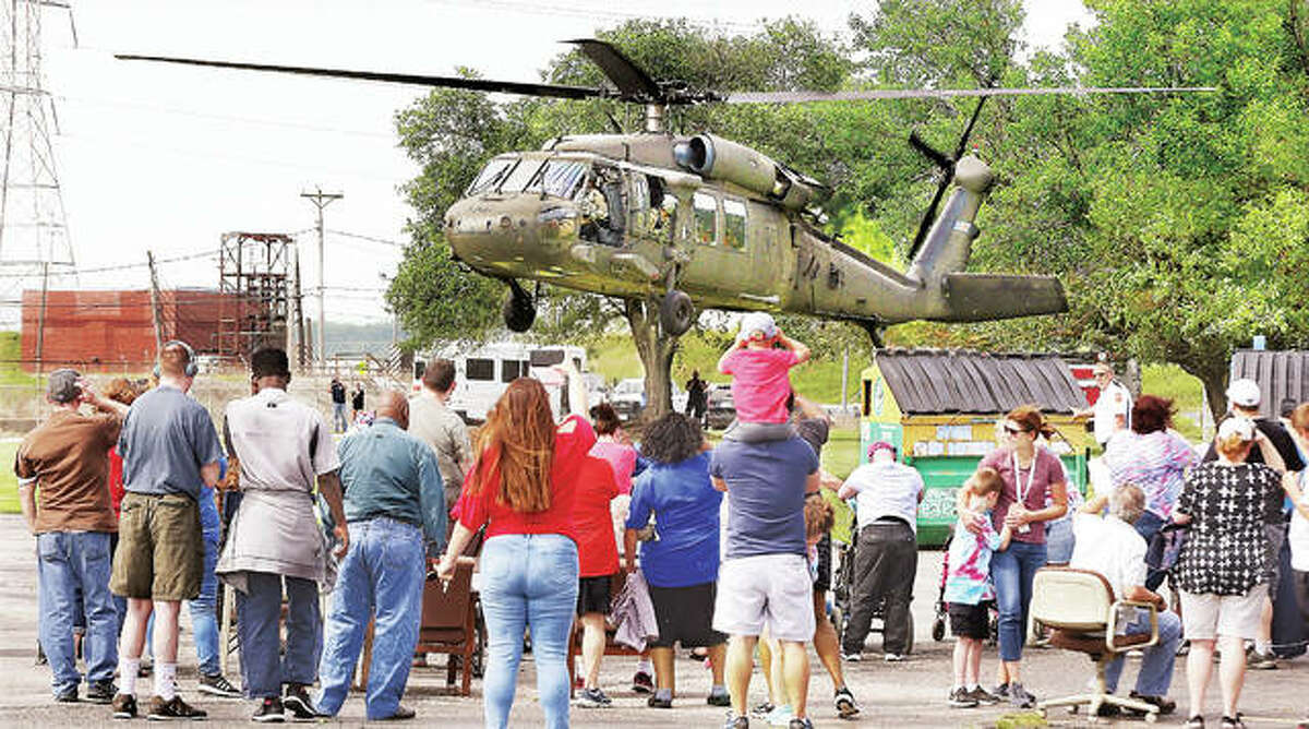 A crowd of students, teachers, police and firefighters got a little more wind than they bargained for Tuesday as a Blackhawk helicopter from the Illinois Air National Guard landed at the William M. BeDell Achievement and Resource Center in Wood River. The chopper and its four crew members shared the large helicopter at the school which teaches those with developmental disabilities.