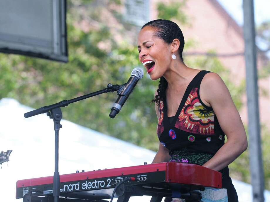Local singer Anitra Brooks, shown performing at the Greenwich Town Party, will play in a children's concert from 3:45 to 4:15 p.m. Friday at the Cos Cob Library. Anitra sings in five different languages and teaches the audience the refrains so they can sing parts of the songs along with her. Photo: File / Hearst Connecticut Media / Greenwich Time