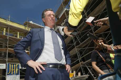 After signing the 2019-2010 California state budget that included historic investments to combat the housing and affordability crises, Mayor Gavin Newsom tours an under-construction affordable housing develpment on Tuesday, July 2, 2019 in Emeryville, Calif.
