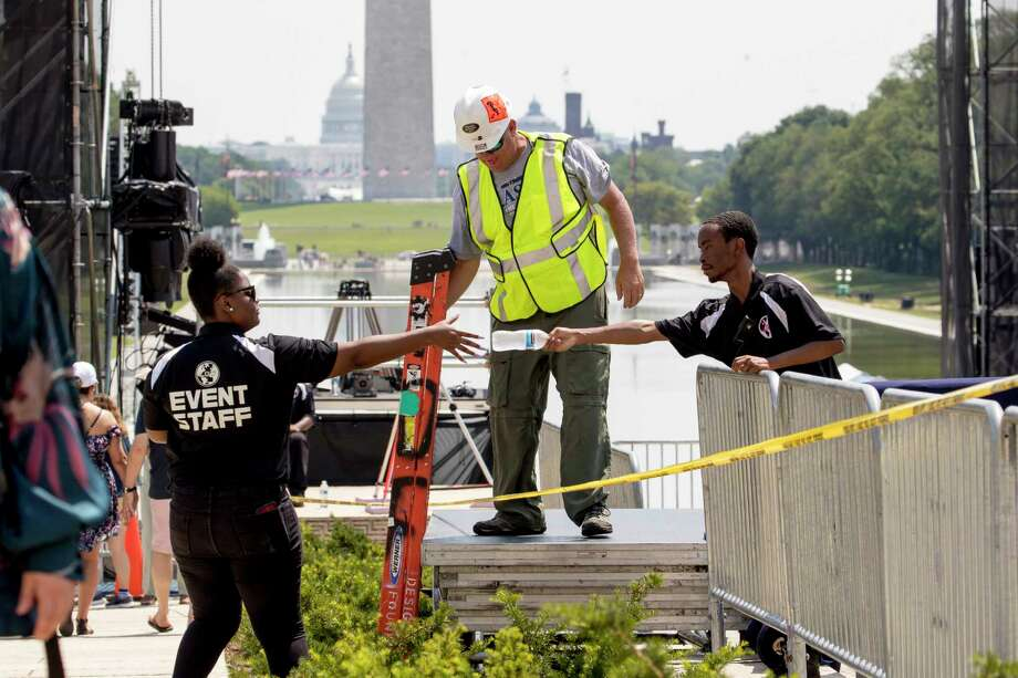 """The Capitol Dome, the Washington Monument and the Reflecting Pool are visible as workers set up for President Donald Trump's 'Salute to America' event honoring service branches on Independence Day at the Lincoln Memorial, Tuesday, July 2, 2019, in Washington. President Donald Trump is promising military tanks along with """"Incredible Flyovers & biggest ever Fireworks!"""" for the Fourth of July. Photo: Andrew Harnik, AP / Copyright 2019 The Associated Press. All rights reserved"""