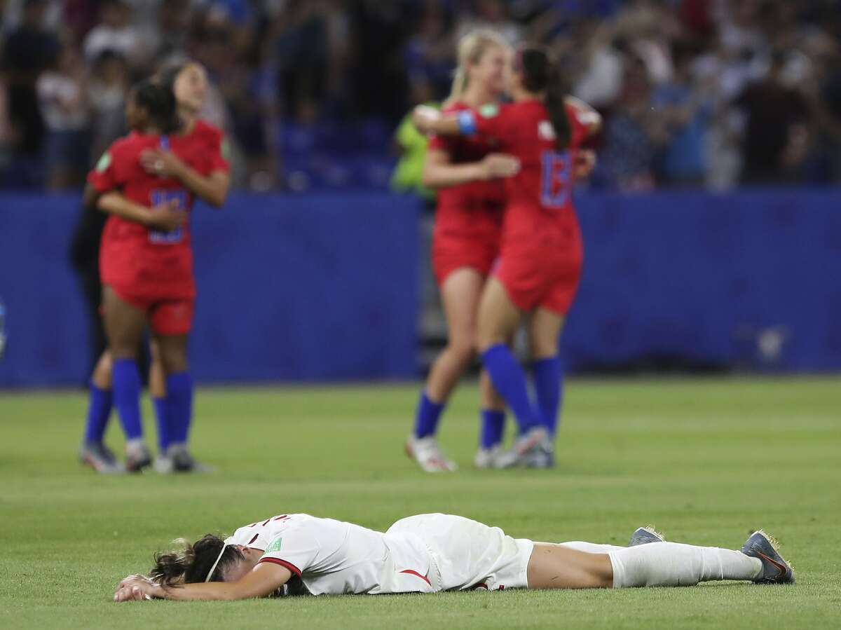 England's Lucy Bronze lies on the pitch in dejection at the end of the Women's World Cup semifinal soccer match between England and the United States, at the Stade de Lyon outside Lyon, France, Tuesday, July 2, 2019. (AP Photo/Laurent Cipriani)
