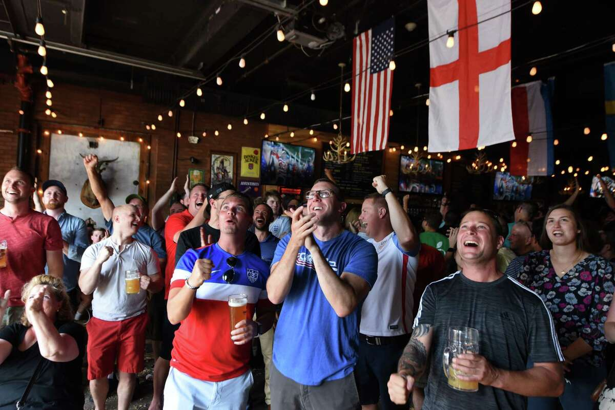 U.S. soccer fans cheer for their team after beating England in a Women's World Cup soccer semi-final game on Tuesday, July 2, 2019, at Wolff's Biergarten in Albany, N.Y. The U.S. squad has advanced to the final on Sunday. (Will Waldron/Times Union)