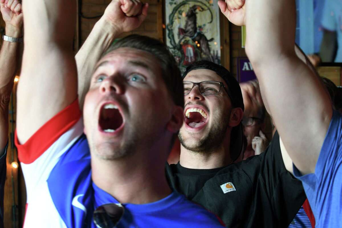 Anthony Caruso of East Greenbush, center, cheers after England missed an equalizing penalty kick late in the second half of the Women's World Cup soccer semi-final against team U.S.A on Tuesday, July 2, 2019, at Wolff's Biergarten in Albany, N.Y. The U.S. squad has advanced to the final on Sunday. (Will Waldron/Times Union)