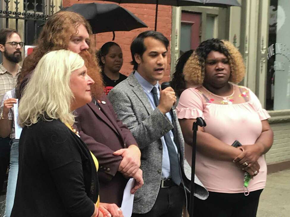 Troy Democratic City Council members Coleen Murtaugh Paratore, Anasha Cummings, David BIssember and Debra Garrett at press conference Tuesday July 2, 2019 supporting renamed sanctuary city resolution.