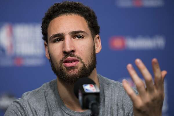 FILE - In this May 29, 2019 file photo Golden State Warriors basketball guard Klay Thompson speaks to the media before practice for the NBA Finals against the Toronto Raptors in Toronto. Thompson announced Monday, July 1, 2019 his decision to stay with the Golden State Warriors for $190 million over the next five years, meaning the five-time reigning Western Conference champions have their 'Splash Brothers' backcourt of Thompson and Stephen Curry locked up long-term. (Nathan Denette/The Canadian Press via AP, file)