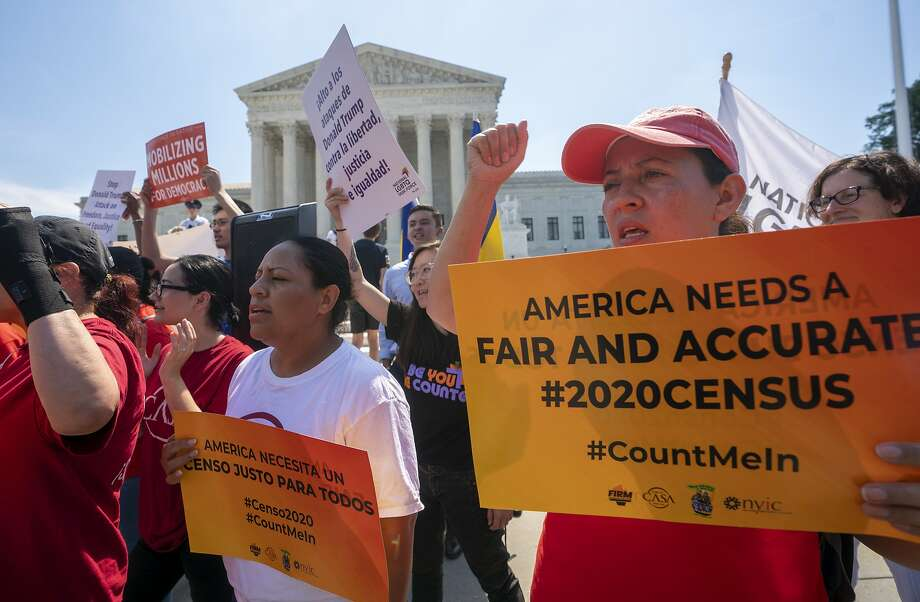 FILE - In this June 27, 2019, file photo, Demonstrators gather at the Supreme Court as the justices finish the term with key decisions on gerrymandering and a census case involving an attempt by the Trump administration to ask everyone about their citizenship status in the 2020 census, on Capitol Hill in Washington. The Justice Department said Tuesday that the 2020 Census is moving ahead without a question about citizenship. (AP Photo/J. Scott Applewhite, File) Photo: J. Scott Applewhite, Associated Press