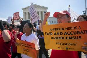 FILE - In this June 27, 2019, file photo, Demonstrators gather at the Supreme Court as the justices finish the term with key decisions on gerrymandering and a census case involving an attempt by the Trump administration to ask everyone about their citizenship status in the 2020 census, on Capitol Hill in Washington. The Justice Department said Tuesday that the 2020 Census is moving ahead without a question about citizenship. (AP Photo/J. Scott Applewhite, File)