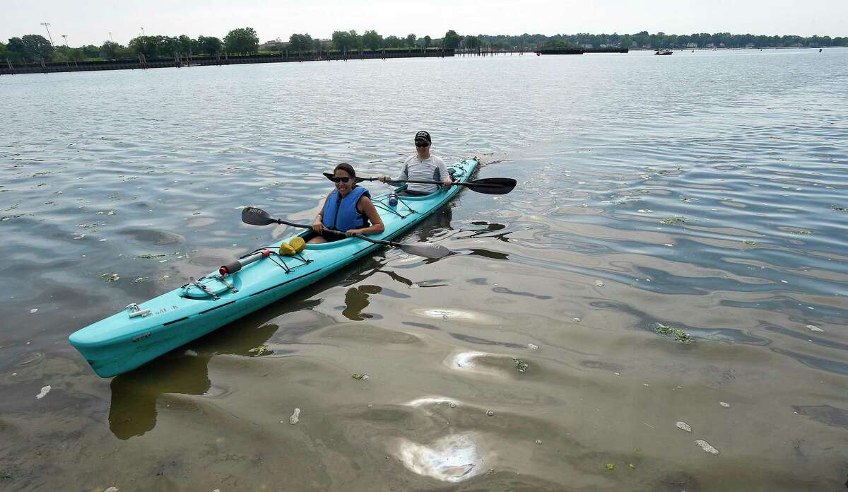 Alexandria Iogman of Stamford and her husband Alec guide their kayak to shore after navigating from Cove Island Park to Boccuzzi Park during the second annual SoundWaters Flotilla on July 14, 2018 in Stamford, Connecticut.